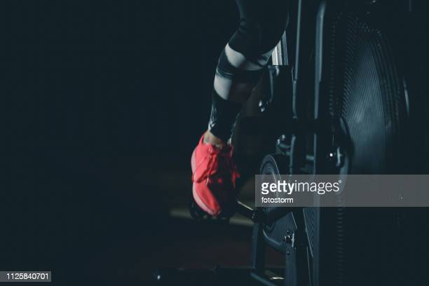 woman pedaling on fan bike - pedal stock pictures, royalty-free photos & images