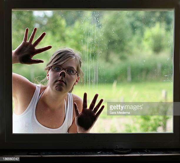 Woman peeking in window