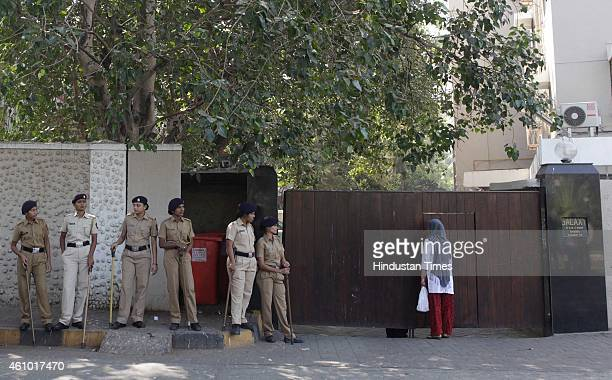 A woman peeps inside the Galaxy Apartments amidst the police security after activists belonging to a Tamil association protested against Bollywood...