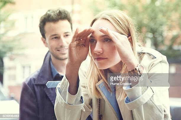 Woman peering through window