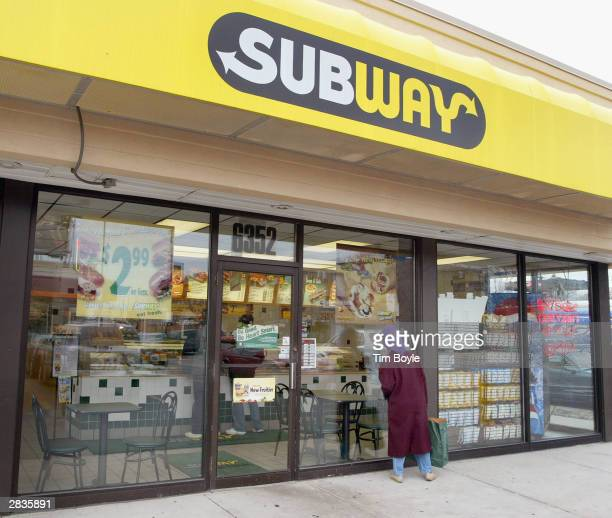 A woman peers into a Subway restaurant December 29 2003 in Chicago Subway restaurants today started to offer two Atkins Nutritionals Incendorsed...