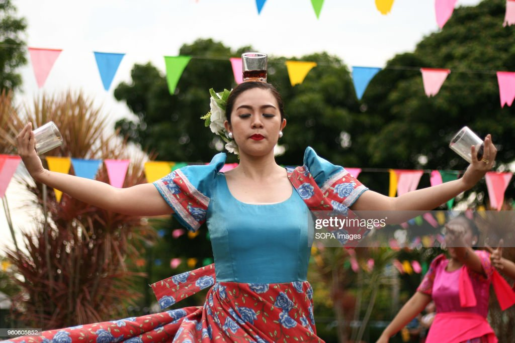 A Woman Perform Filipino Dances While Wearing Native Costumes Made