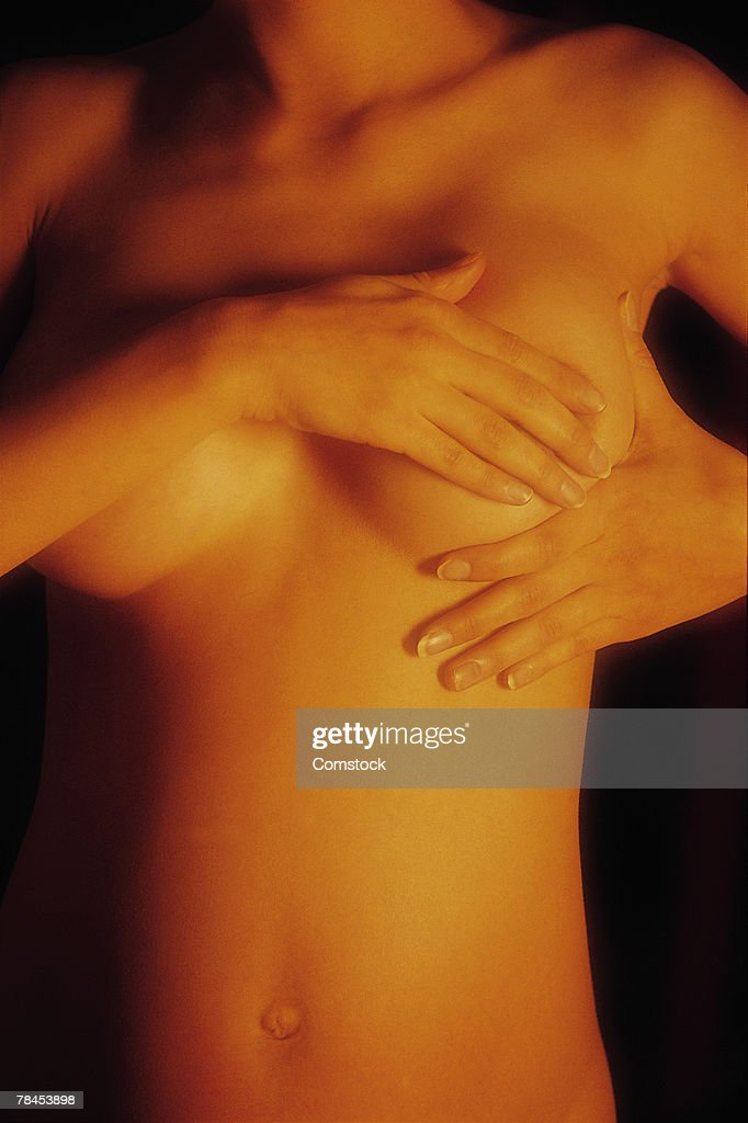 Woman performing breast self exam : Stockfoto