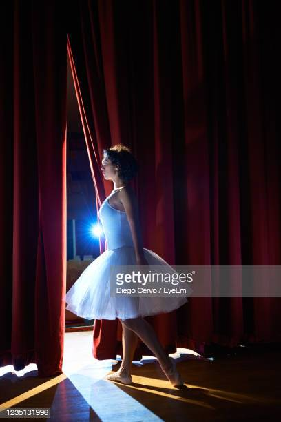 woman performing in stage - premiere stock pictures, royalty-free photos & images