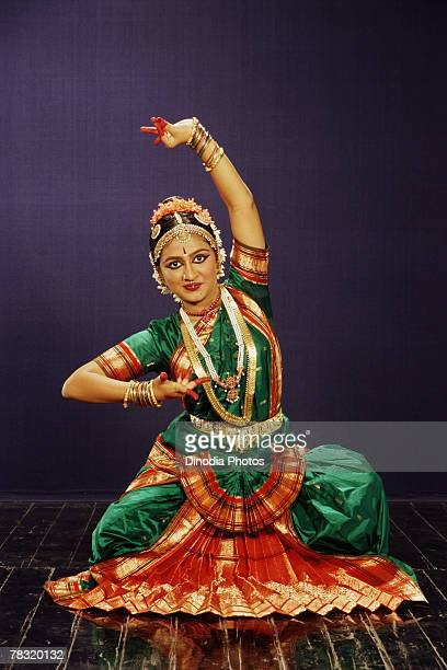 Woman performing Indian Bharat Natyam dance