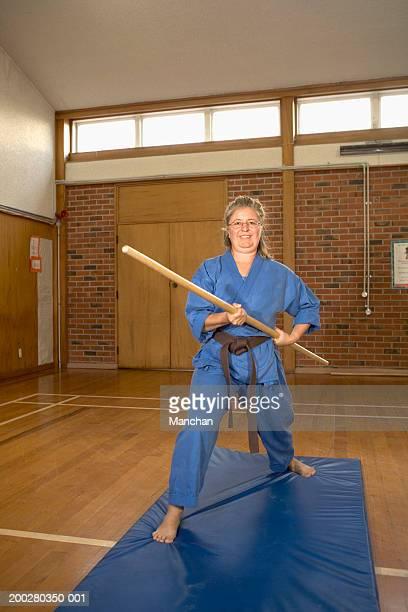 Woman performing Ken-Do-Kai Karate, smiling, portrait