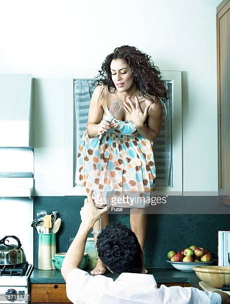 woman performing on a counter top - women whipping men stock photos and pictures