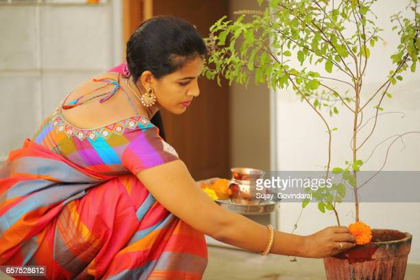 woman performing pooja - religion stock pictures, royalty-free photos & images