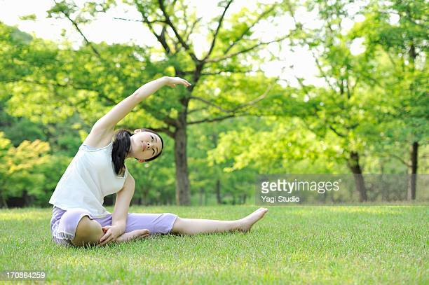 Woman performing stretching exercises in nature