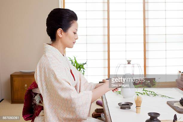 Woman Performing Tea Ceremony Wearing Kimono
