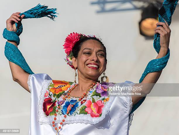 SQUARE TORONTO ONTARIO CANADA Woman performing the Flamenco folk dance on stage with a shawl as a prop at MexFest 2015 in Toronto The woman is...