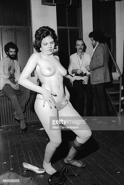 A woman performs a striptease at a Halloween party in SoHo New York New York October 31 1974