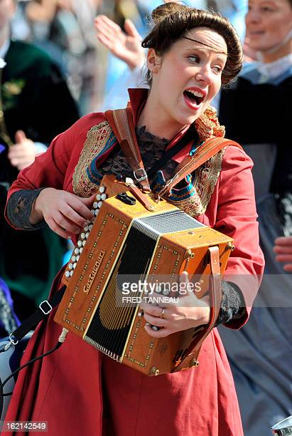 A woman performs Breton traditional music with an accordion on August 7 2011 in Lorient during the celtics nations Great Parade of the 'festival...