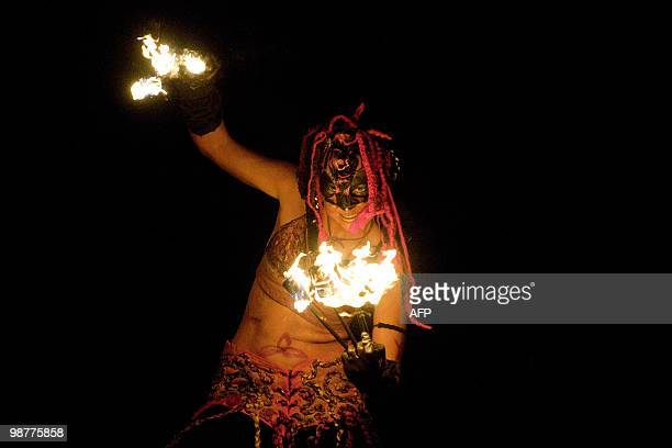 A woman performs during the Beltane Fire Festival in Edinburgh on April 30 2010 The event which celebrates an ancient Celtic festival is a...