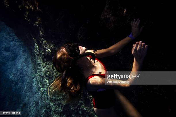 """Woman performs free-diving in the clear water of """"Suluada"""" which is located 7 kilometers from Cape Gelidonya and also favorite spot location for deep..."""