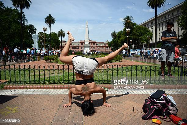 A woman performs in Plaza de Mayo square in Buenos Aires on December 3 during the 6th national march of marijuana calling for the decriminalization...