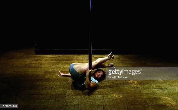 A woman performs pole tricks during a Polepeople pole dancing class May 3 2006 in London England Since celebrities hailed pole dancing as the latest...