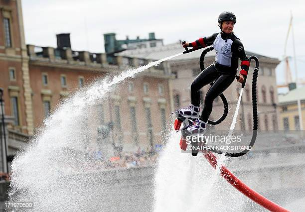 A woman performs with a flyboard during the 'Red Bull Flugtag' on June 30 2013 in Stockholm Some 27 teams took part in the competition by launching...