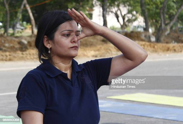 A woman performs yoga during a Raahgiri Day an event organised by MCG at Sector 55 Golf Course Road in Gurugram India on Sunday July 01 2018 Various...