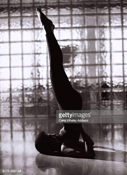 Woman Performs Yoga