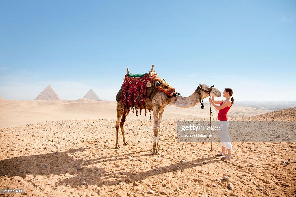 Woman petting a camel : Stock Photo