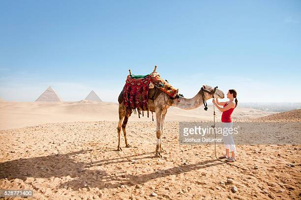 Woman petting a camel