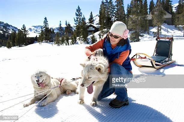 Woman petting sled dog