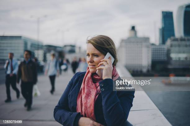 woman phoning in the street. - northern european descent stock pictures, royalty-free photos & images