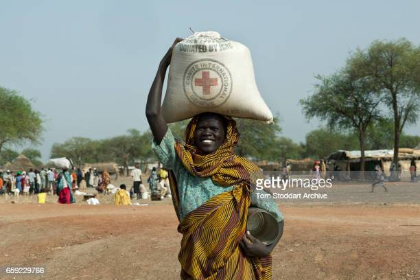 A woman photographed in Abathok village during an International Committee of the Red Cross distribution of seeds agricultural tools and food staples...
