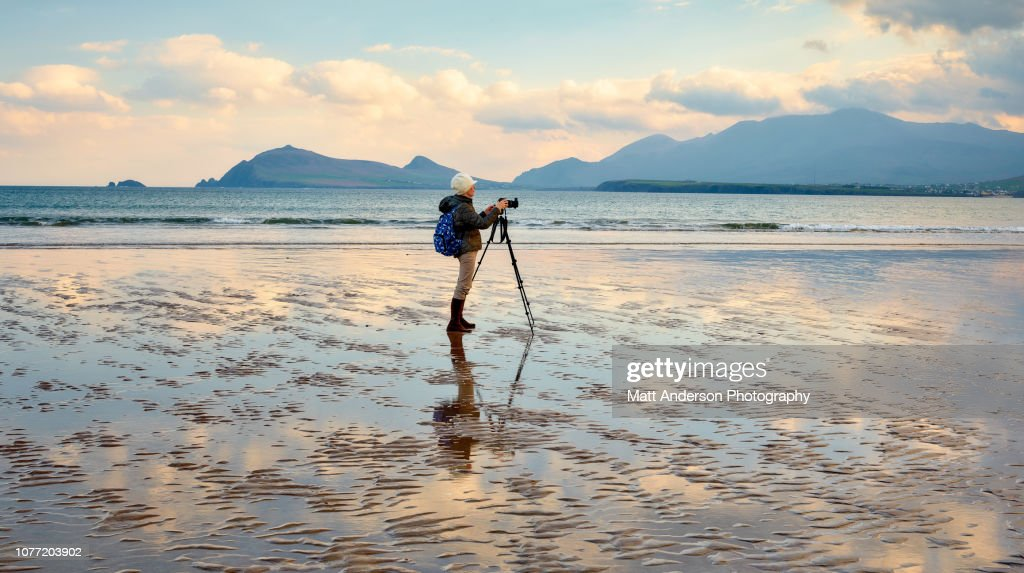 Woman Photographing at Smerwick Harbor : ストックフォト