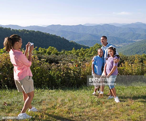 woman photographing father with children (10-13) - asheville stock pictures, royalty-free photos & images
