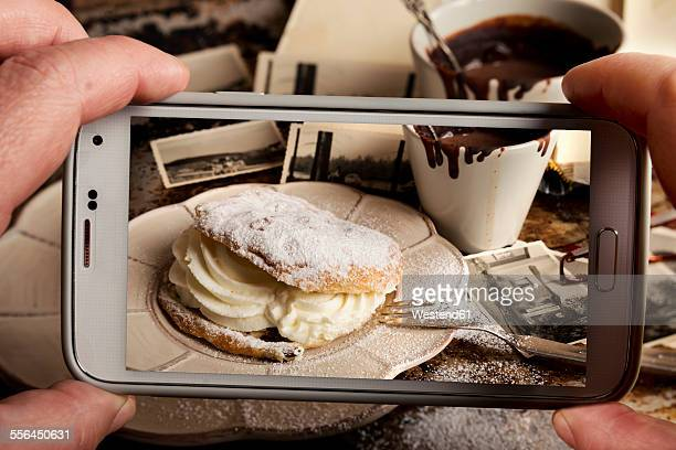Woman photographing food with smartphone