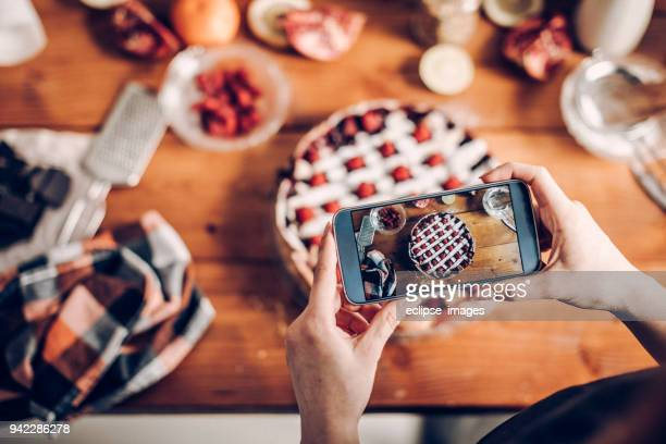 woman photographing her cake - hitting stock pictures, royalty-free photos & images