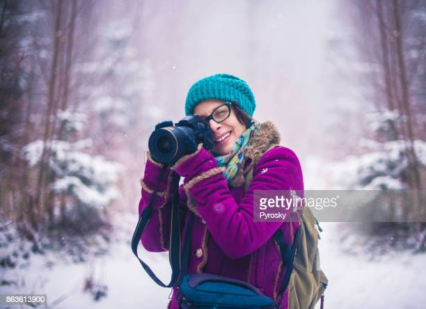 Woman photographing in nature
