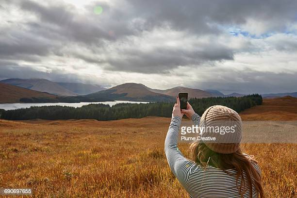 woman photographing nature - photographing stock pictures, royalty-free photos & images