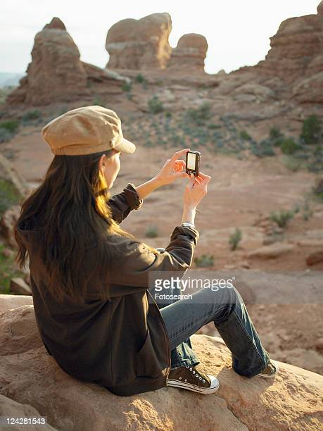 Woman photographing rock formations