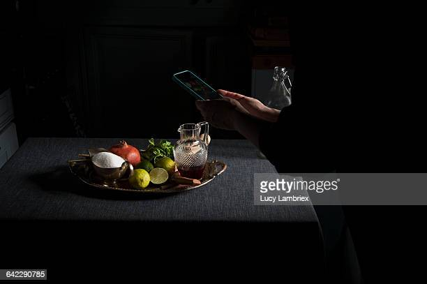 Woman photographing styled food