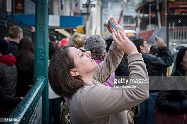 CONTENT] Woman photographing the Freedom Tower One World Trade Center under construction in Lower Manhattan New York City New York