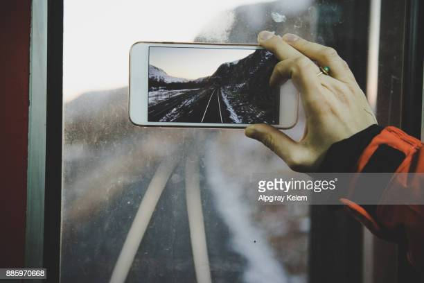 Woman photographing view through smart phone