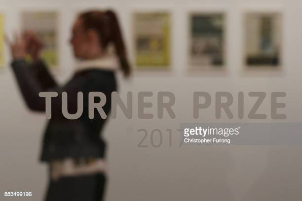 A woman photographs installations during a press preview for the 2017 Turner Prize at The Ferens Art Gallery on September 25 2017 in Hull England An...
