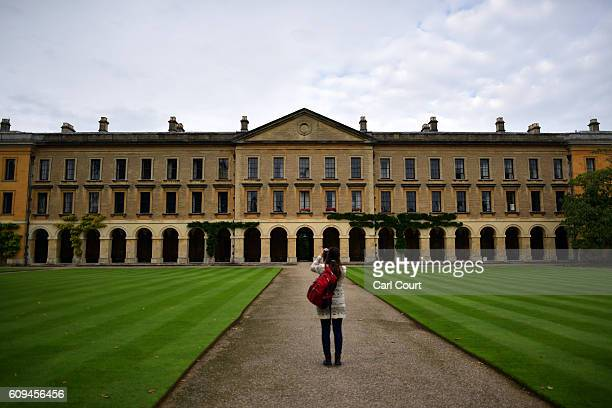 A woman photographs part of Magdalen College on September 20 2016 in Oxford England Oxford University has taken number one position in the 20162017...