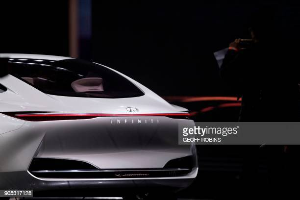 A woman photographs the Infiniti Q Inspiration during the Press Preview for the 2018 North American International Auto Show in Detroit Michigan...