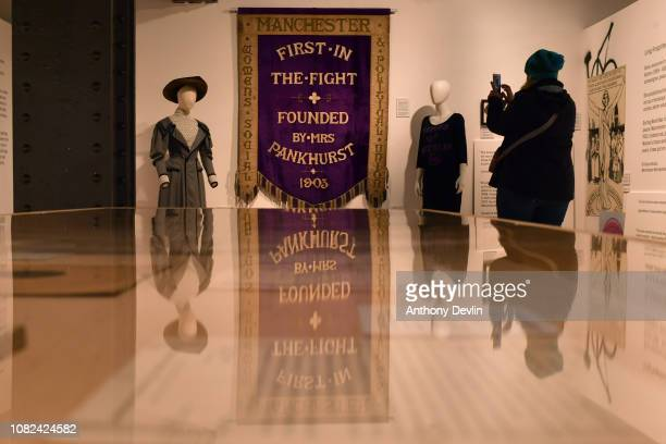 A woman photographs the Manchester Suffragette banner on display in the People's History Museum ahead of the unveiling of a statue of the suffragette...