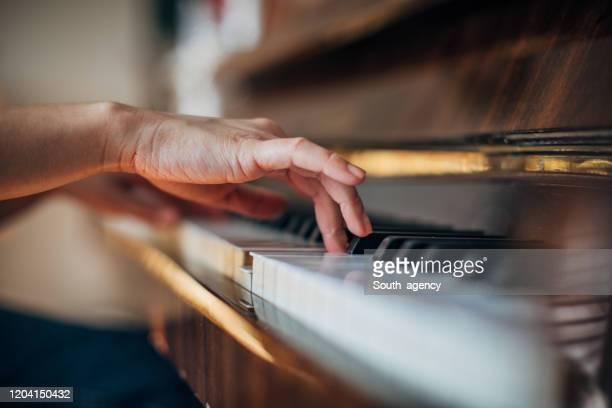 woman pianist playing piano - piano stock pictures, royalty-free photos & images
