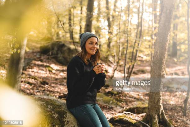 woman picking mushrooms and drinking coffee in the forest - nordic countries stock pictures, royalty-free photos & images