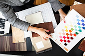 Woman picking out swatches from desk