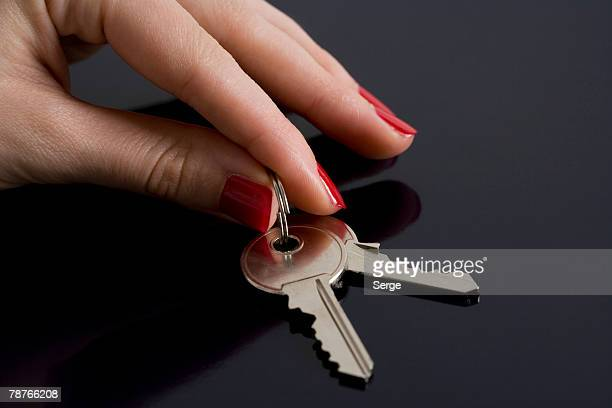 A woman picking up some keys