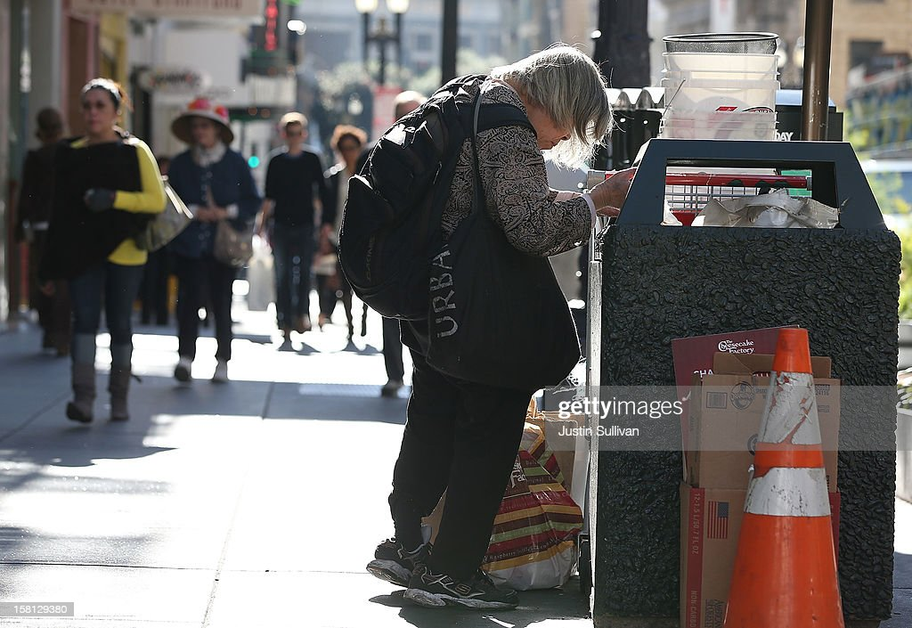 A woman picks through a garbage can on December 10, 2012 in San Francisco, California. Despite efforts from the Federal Government and local officials to provide more shelters and beds for homeless people, the number of people living on the streets remained unchanged from January 2011 to January 2012. The number of homeless families increased while the number of veterans on the street decreased.