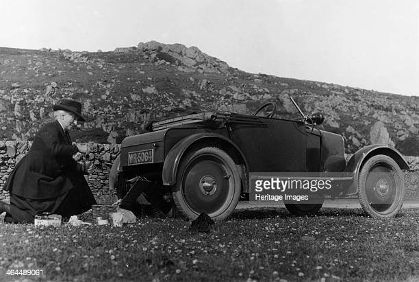 A woman picnicking next to her aircooled Rover 8 c1919c1925