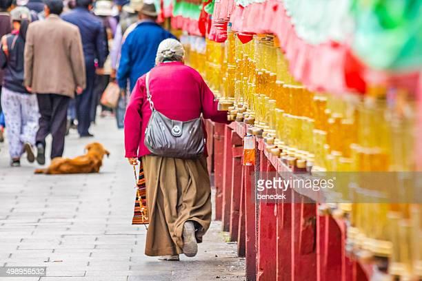 Woman Pilgrim Turns Prayer Wheels in Lhasa Tibet China